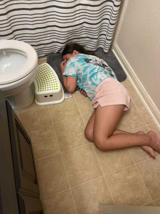 Elin McLain, 9, couldn't get off the bathroom floor at one point after contracting COVID-19. (Courtesy Heather McLain)