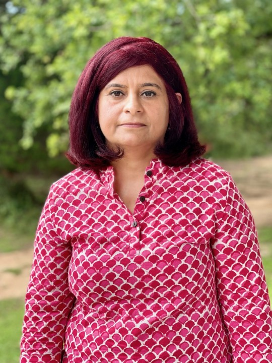 Shally Kakkar poses in a pink top. She bought the home in Leander for her parents.