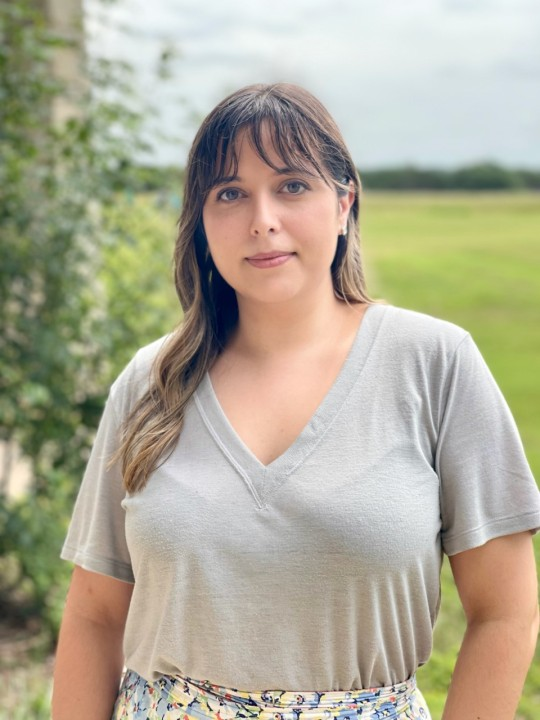 Tara Vaughn poses in a gray shirt. She was hoping to grow her family in her new home in Manor.