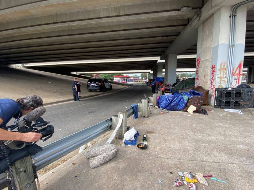 People camp underneath an overpass in South Austin