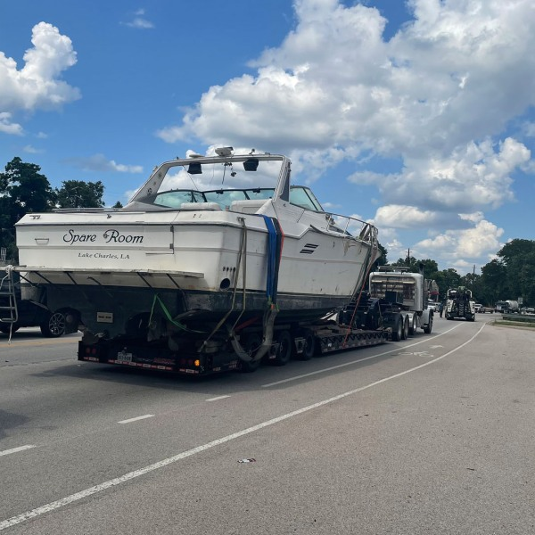 Boat on trailer being transported down SH 71 (Photo: Travis County Sheriff's Office)