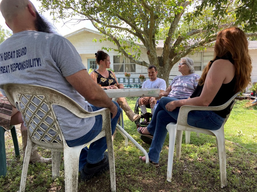 Family sits in circle