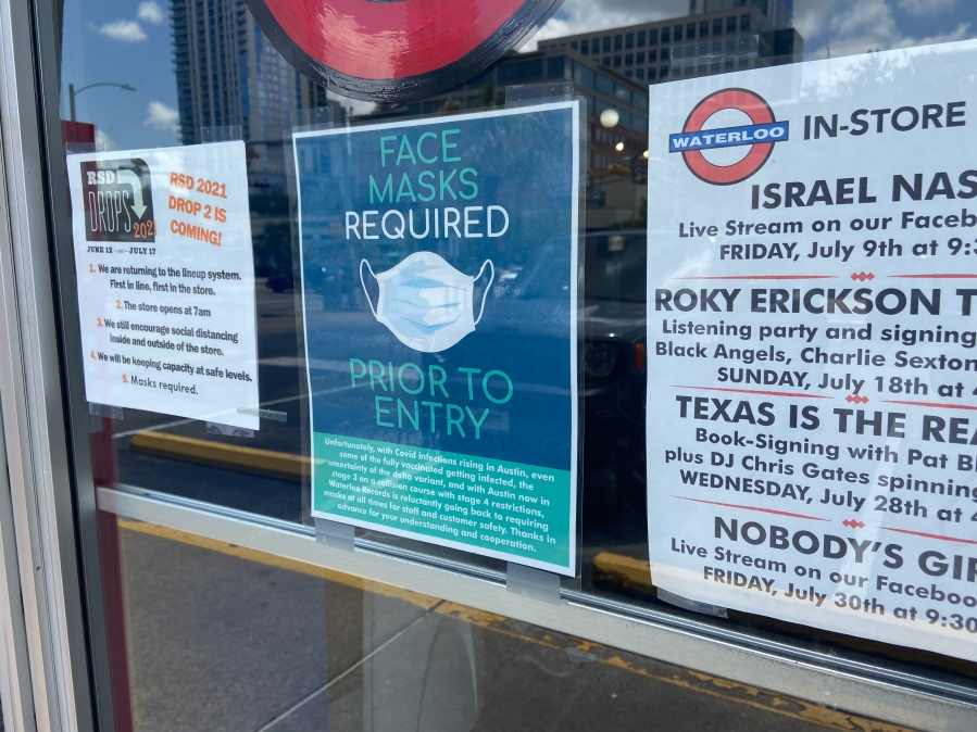 A sign on Waterloo Records warns of mask requirement