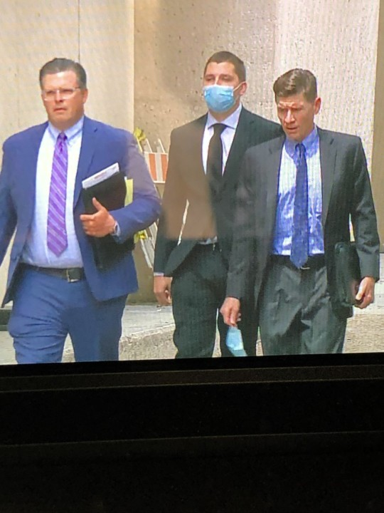 Officer Karl Krycia (pictured in middle) was involved in an incident where excessive force was used and led to the death of Dr. Mauris DeSilva. Officer Christopher Taylor was the other officer involved in the 2019 death. (KXAN Photo/Ed Zavala)