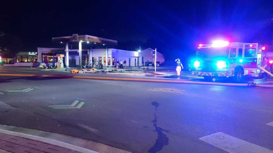 An electric car crashed into a gas station in west Austin early Thursday morning. It took firefighters longer than usual to put the fire out because they had to monitor the car's batteries. (KXAN photo/Andrew Choat)