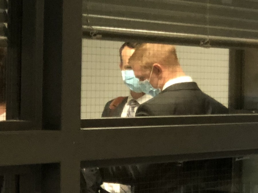 Officer Christopher Taylor (pictured in front) was indicted in a case that alleges he and another officer used excessive force, which led to the death of Dr. Mauris DeSilva. (KXAN Photo/Chris Nelson)
