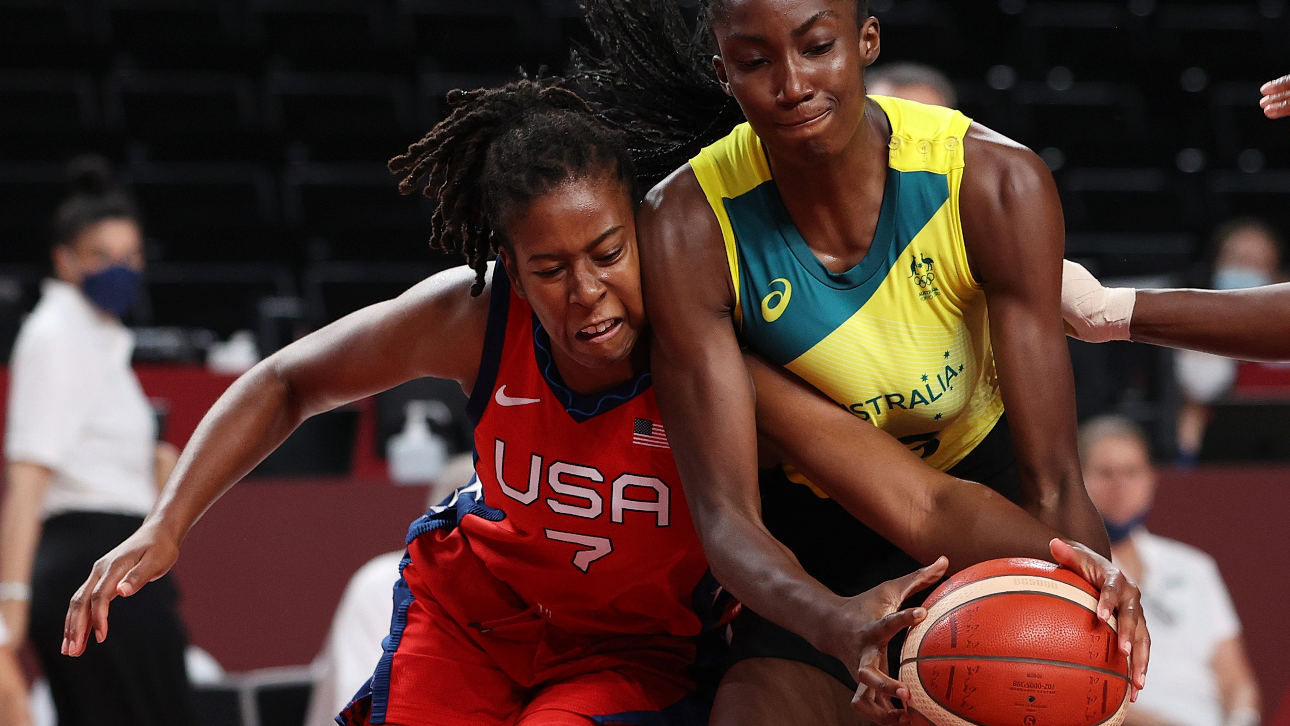 SAITAMA, JAPAN - AUGUST 04: Ariel Atkins #7 of Team United States and Ezi Magbegor #13 of Team Australia fight for possession during the second half of a Women's Basketball Quarterfinals game on day twelve of the Tokyo 2020 Olympic Games at Saitama Super Arena on August 04, 2021 in Saitama, Japan. (Photo by Kevin C. Cox/Getty Images)