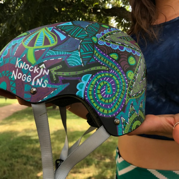 Leah Chyma created Knockin' Noggins, a custom design helmet business, after suffering a traumatic brain injury in August 2018. (KXAN Photo/Kelsey Thompson)