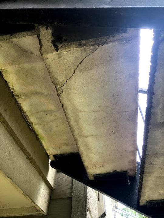 Photo showing a cracked staircase at Mahoney's apartment complex. (Courtesy Denise Mahoney)