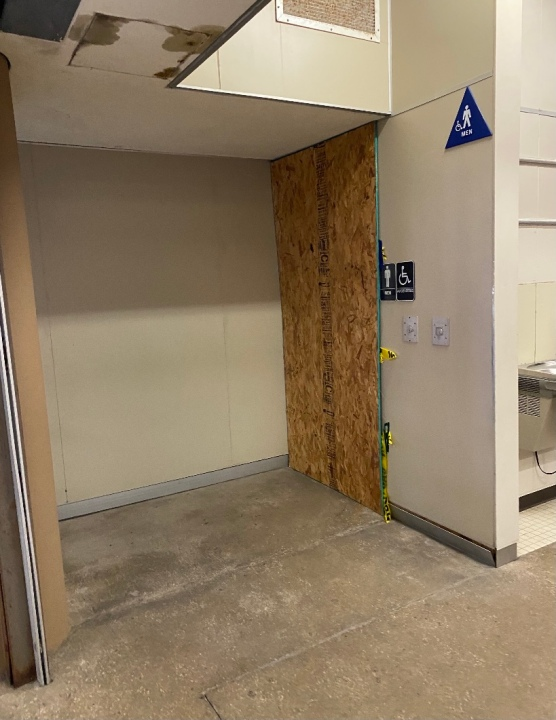 The boys restroom  pictured boarded up at Bowie High School, as HVAC issues plague some campuses two weeks into the school year. (Photo provided by a Bowie High school family)