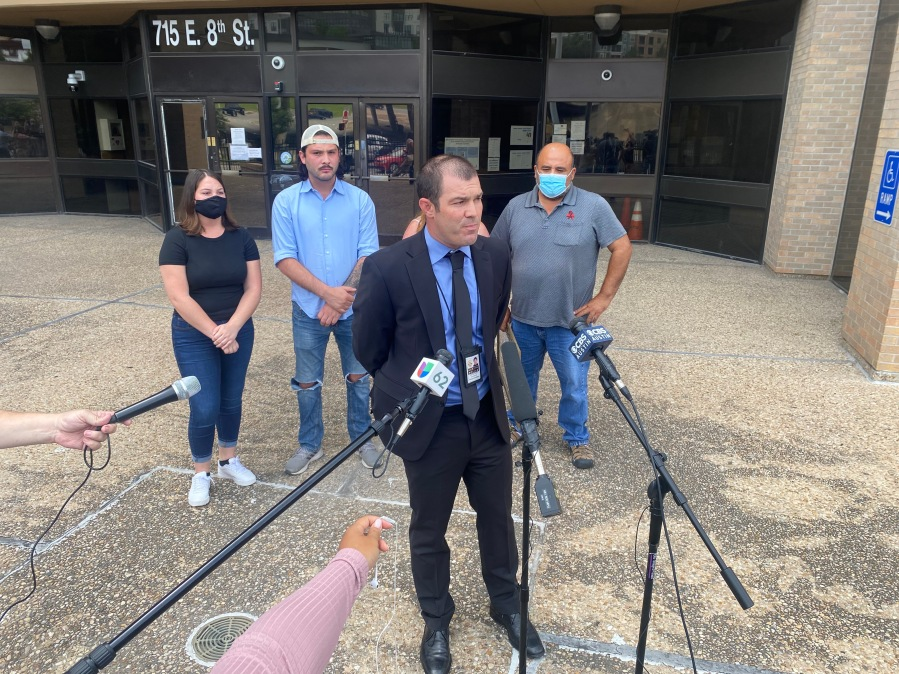 The family of Nikolas Martinez, a man stabbed to death in south Austin in July, asked the public for help trying to find the person responsible for his death. They, along with an APD detective, spoke outside APD headquarters Tuesday. (KXAN photo/Jacqulyn Powell)