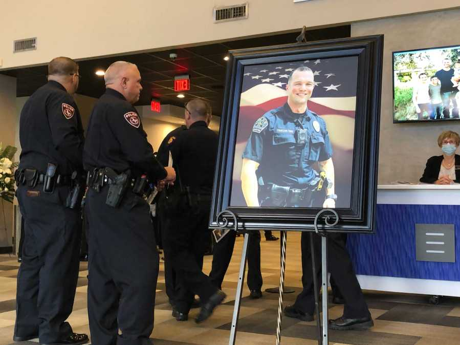 """Funeral services for APD officer Lewis """"Andy"""" Traylor are taking place Monday at Shoreline Church. (KXAN photo/Chris Nelson)"""