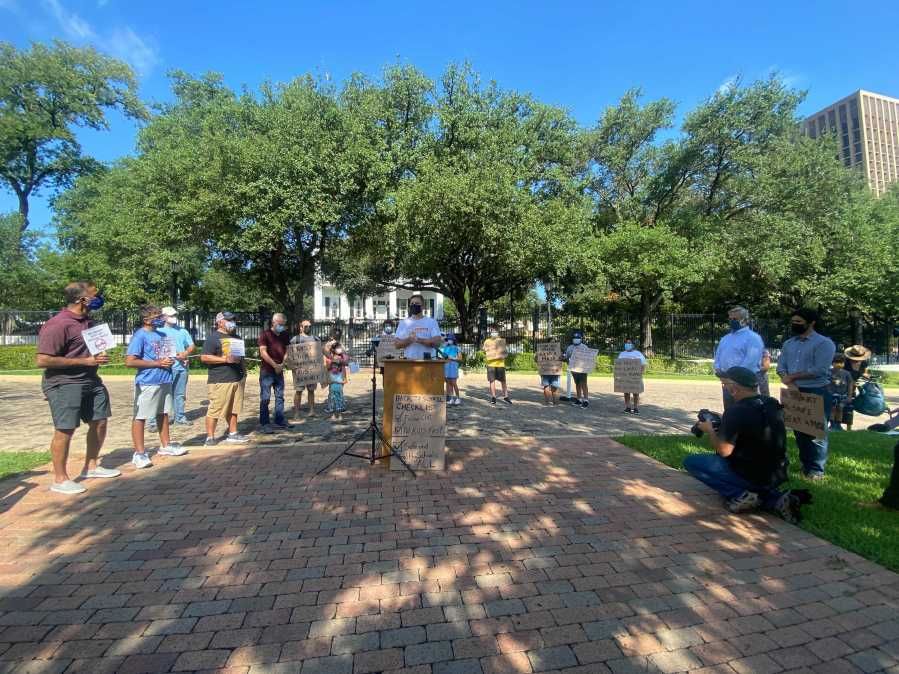 A group of parents and children gathered in front of the Governor's mansion Monday to urge Gov. Greg Abbott to give local control to school districts to impose mask mandates. (KXAN photo/Todd Bynum)