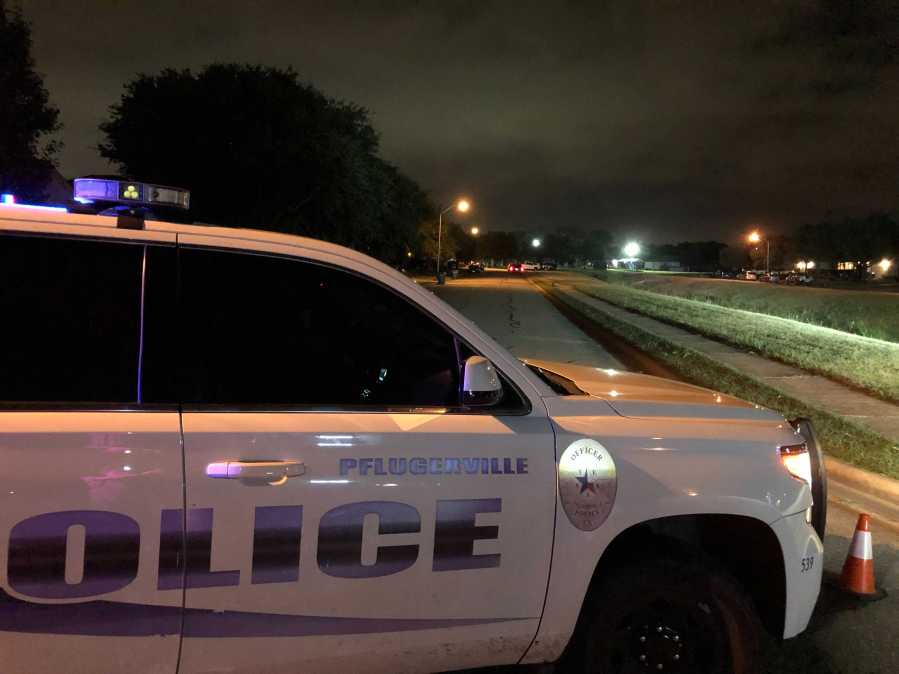 A Pflugerville police officer shot and killed someone who they say had a weapon and was trying to break down a door on Larnak Loop early Wednesday morning. (KXAN photo/Julie Karam)