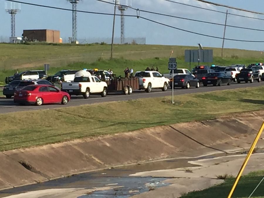 Austin police are investigating after an officer-involved shooting along US Highway 183 near the airport. (KXAN Photo/Juan Salinas)
