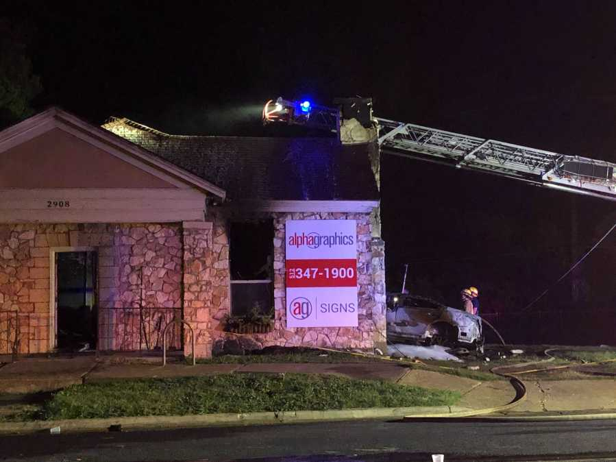 A car ran into a print shop early Wednesday morning on North Lamar Boulevard near 30th Street. One person went to the hospital with critical injuries following the crash. (KXAN photo/Julie Karam)
