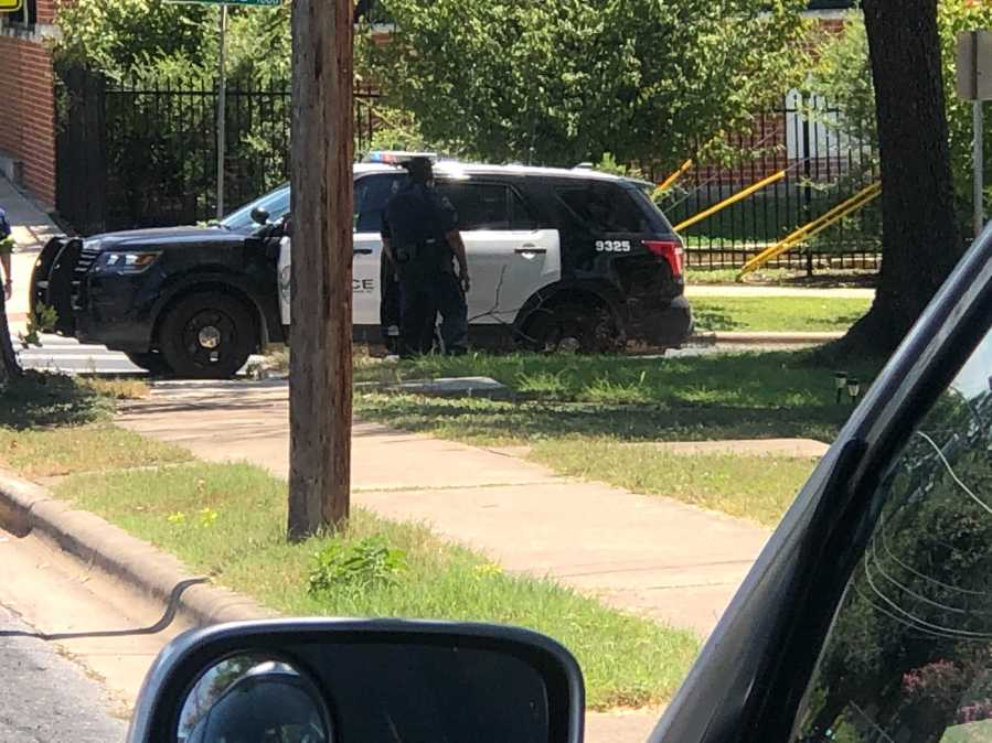 There's a heavy police presence on 11th Street near Huston-Tillotson University and two AISD schools as police investigate a call about someone who is possible armed with a weapon. (KXAN photo/Frank Martinez)