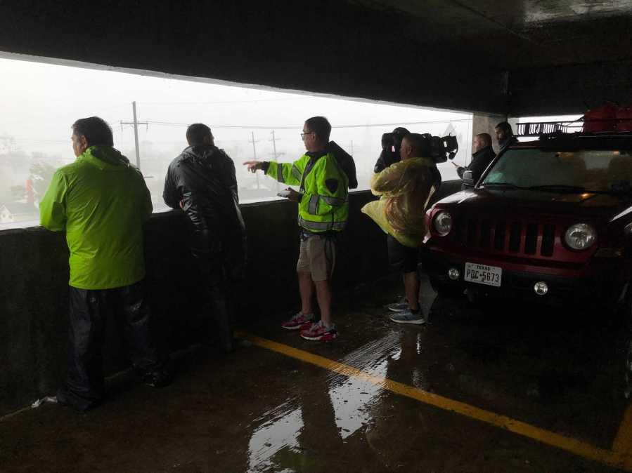 News crews during Hurricane Ida