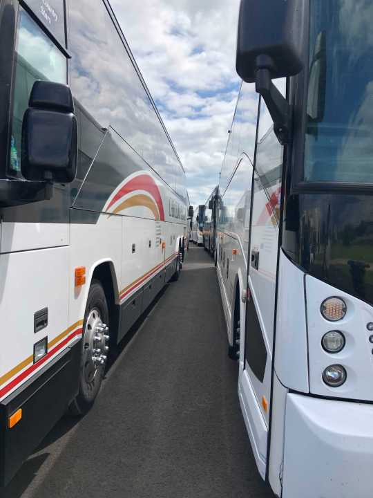 More than 50 coach buses line up in Lafayette, Louisiana to evacuate people from the coast after Hurricane Ida. (KXAN Photo/David Yeomans)