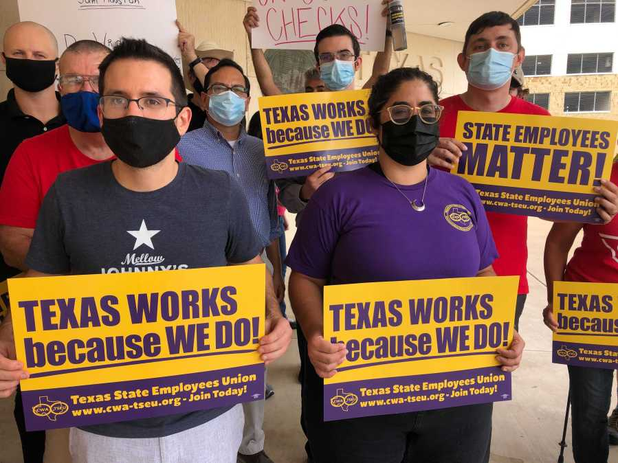 State employees protested in downtown Austin Thursday evening, calling for Gov. Greg Abbott to restore Article 10 funding. (KXAN Photo/Frank Martinez)