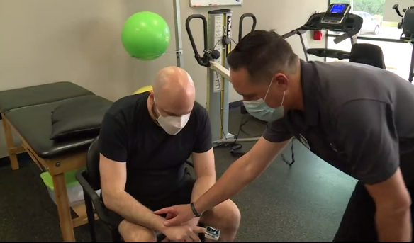 Brandon Johnson takes part in physical therapy as treatment for Long-COVID.