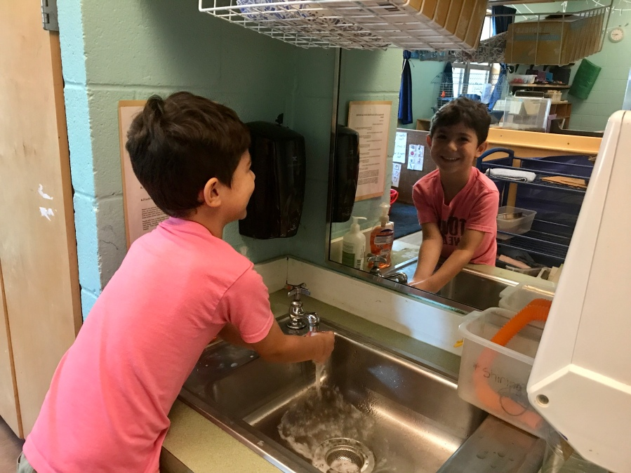 Students washing hands at Mainspring Schools to help with the spread of COVID-19. (Courtesy Mainspring Schools)