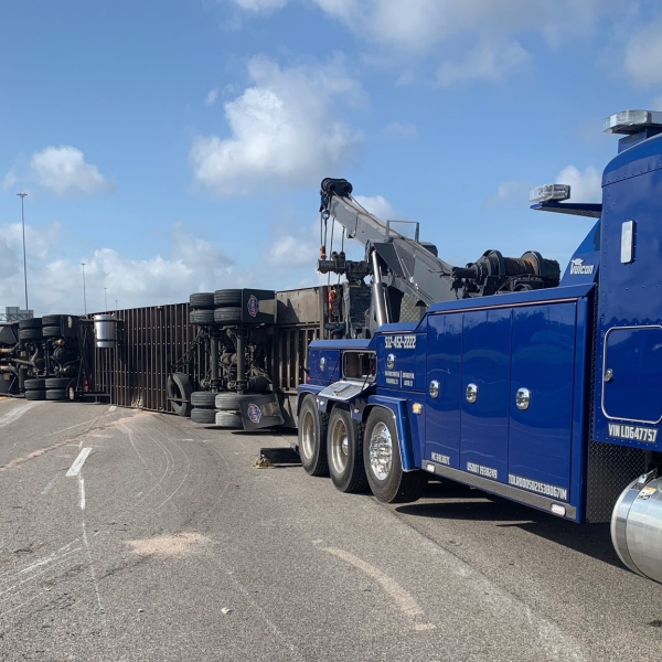 An 18-wheeler rolled over and shut down traffic on I-35 southbound Thursday morning. A tow truck is on scene to clear the wreck. (Round Rock PD photo)