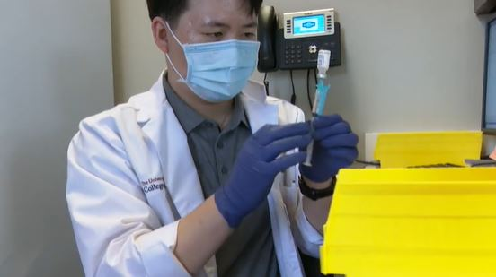 A pharmacist draws up a dose of Pfizer vaccine at Tarrytown Pharmacy (KXAN Photo/Avery Travis)