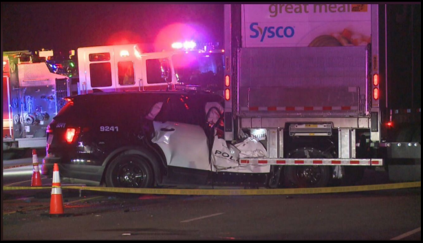APD says Officer Traylor was responding to a call when a semi-truck made a U-turn in front of his patrol car. (Photo included in lawsuit)