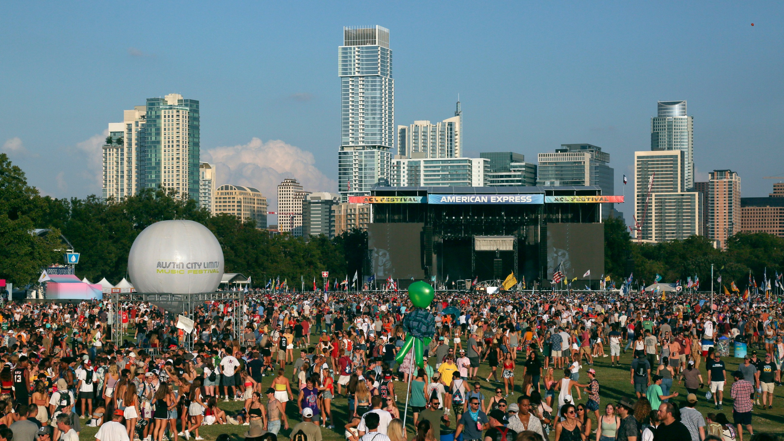 Festival attendees walk through Zilker Park during the first weekend of the Austin City Limits Music Festival on Friday, Oct. 4, 2019, in Austin, Texas. (Photo by Jack Plunkett/Invision/AP)
