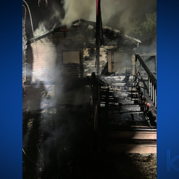 Picture of a burned house on Blue Bluff Road
