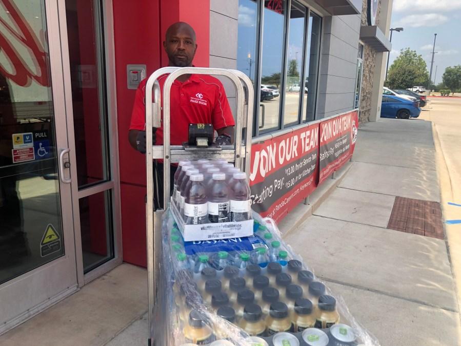 Kendrick Fulton delivers sodas while on community confinement (KXAN Photo/Matt Grant)