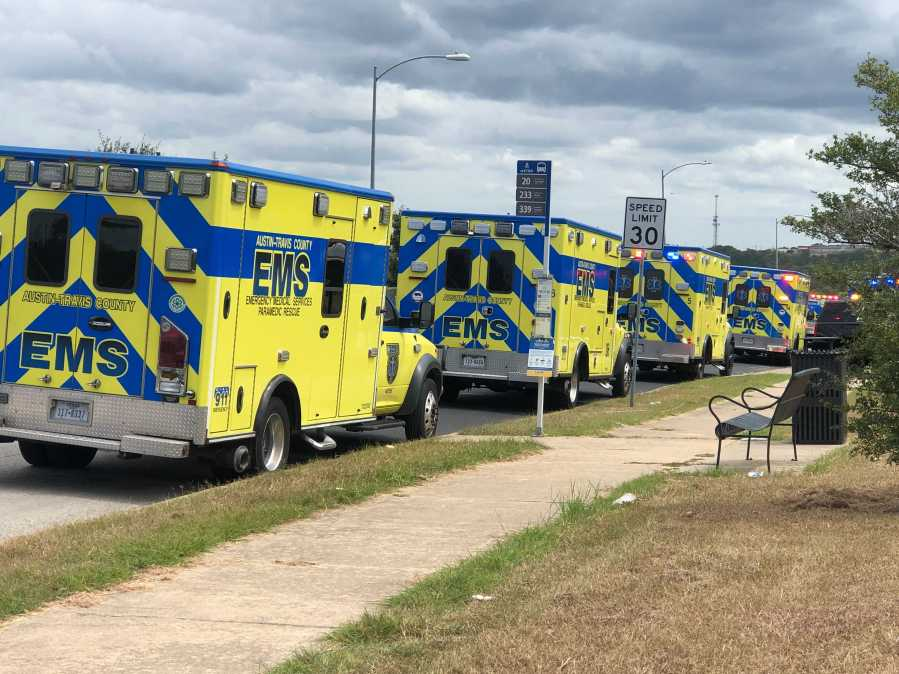 """Emergency personnel staged at the Delco Center, a few blocks from LBJ Early College High School where Monday a """"reported active attack"""" was being investigated. There are no reported shots fired so far. (KXAN photo/Frank Martinez)"""