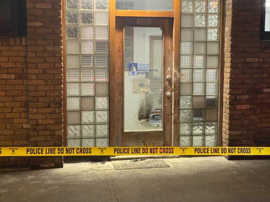 Broken windows outside Travis Co. Democratic office following possible arson. (KXAN, Nabil Remadna)