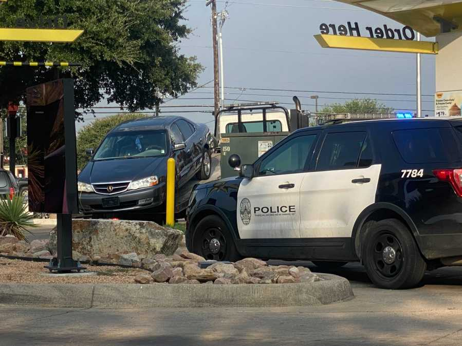 A suspect was taken into custody after police responded to a call on Airport Boulevard in east Austin on Wednesday. (KXAN photo/Todd Bynum)