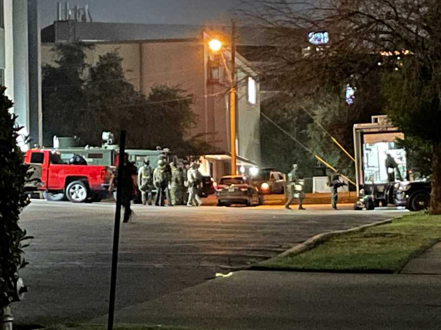 A SWAT team responded to an office building on I-35 in south Austin early Thursday for what was believed to be a person inside the building with a gun. Authorities found one person at the scene, but no one else. (KXAN photo/Tim Holcomb)
