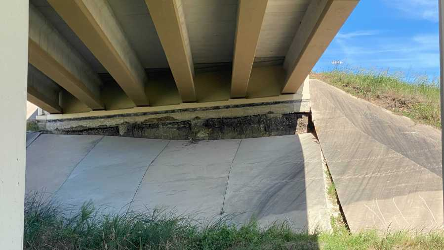 The Texas Department of Transportation is evaluating damages to the underside of a bridge near SH 45 and the U.S 183 frontage road. (KXAN Photo/Todd Bynum)