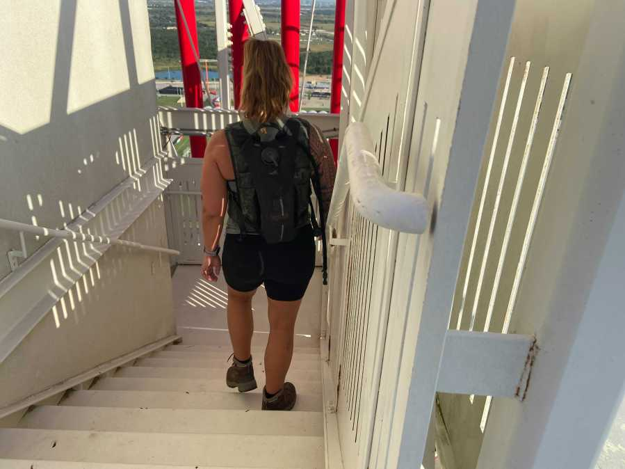 Participants in the COTA 9/11 memorial event climb stairs to the observation deck and back down four times to mimic the number of floors (110) in both Twin Towers of the World Trade Center. (KXAN Photo/Grace Reader)