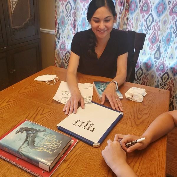 Learning Bridge volunteer tutor helps foster youth. (Source: Andrea Brauer)