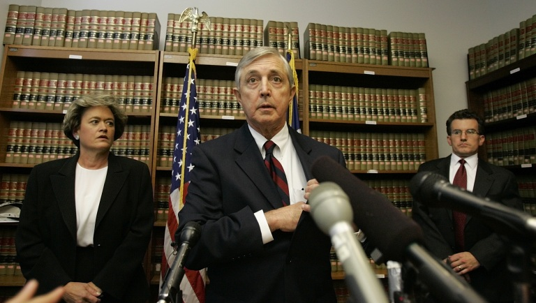 Former Travis County District Attorney Ronnie Earle, center, speaks in 2005 after a grand jury charged U.S. Rep. Tom DeLay with conspiracy in a campaign finace scheme – one of the highest-profile cases in the history of the Public Integrity Unit. The unit – led for years by Gregg Cox, right – was part of the Travis County district attorney's office since 1978, until Earle's Democratic successor Rosemary Lehmberg, left, was involved in a political dustup with then-Gov. Rick Perry, a Republican, in 2013. The unit handled corruption cases against state officials with funding from the legislature, until Perry threatened to veto that money if Lehmberg refused to resign after a drunken-driving conviction. That threat led to criminal charges – later dropped – alleging Perry misused the power of his office. The matter rallied Republican support for moving the unit out of Travis County. (AP Photo/Harry Cabluck)