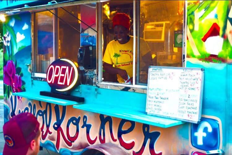 Nahika Hillery serves customer at Kreyòl Korner Caribbean Cuisine.