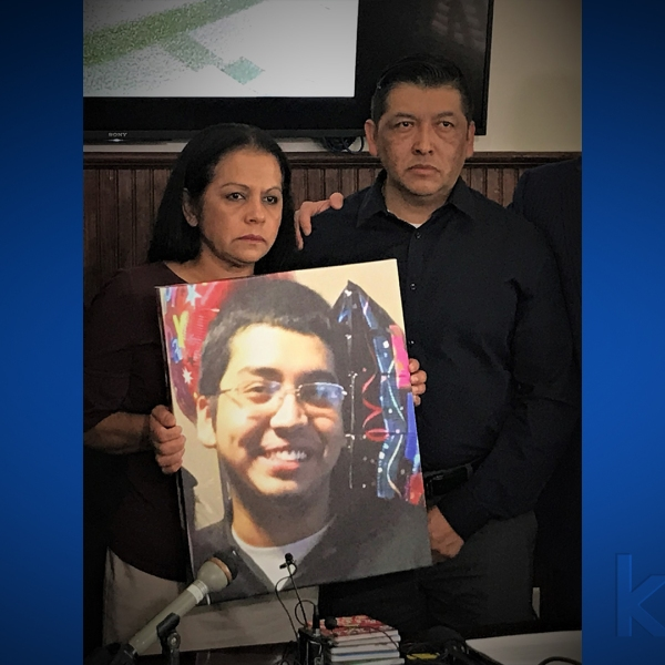 The Roque family with a picture of Jason. (KXAN photo)