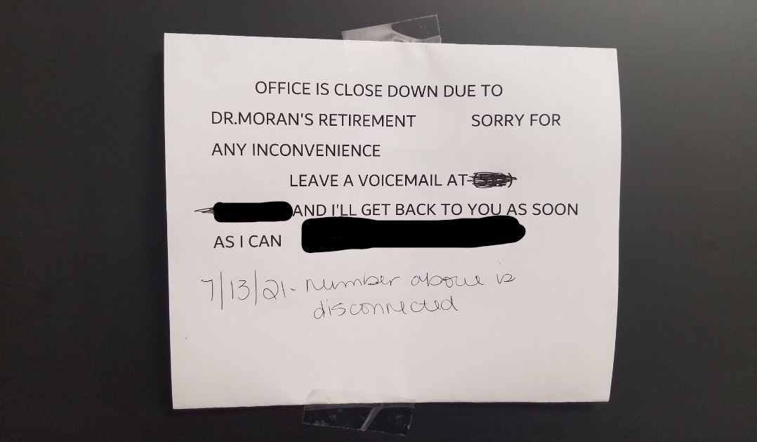 The note posted to the door of Dr. Moran's office upon his retirement.