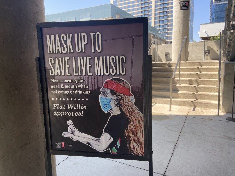 Sign reminds people to wear their masks inside Moody Theater
