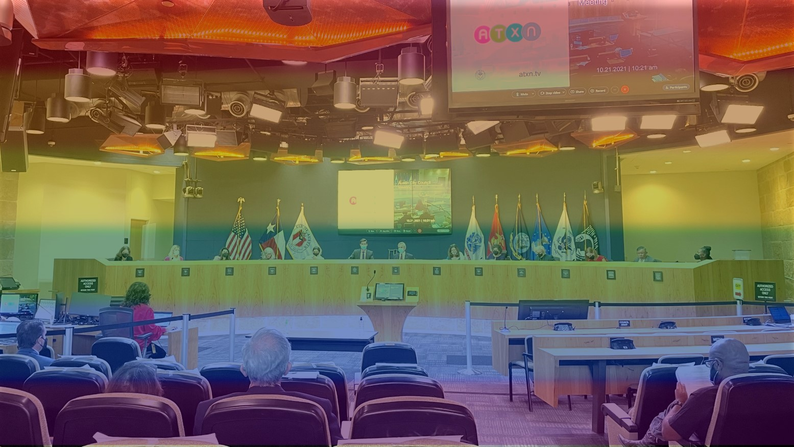 A photo of Austin City Council in rainbow colors