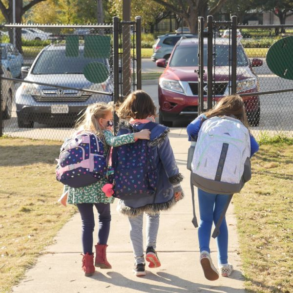 School children wearing facemasks walk outside Condit Elementary School in Bellaire, outside Houston, Texas, on December 16, 2020. - (Photo by FRANCOIS PICARD/AFP via Getty Images)