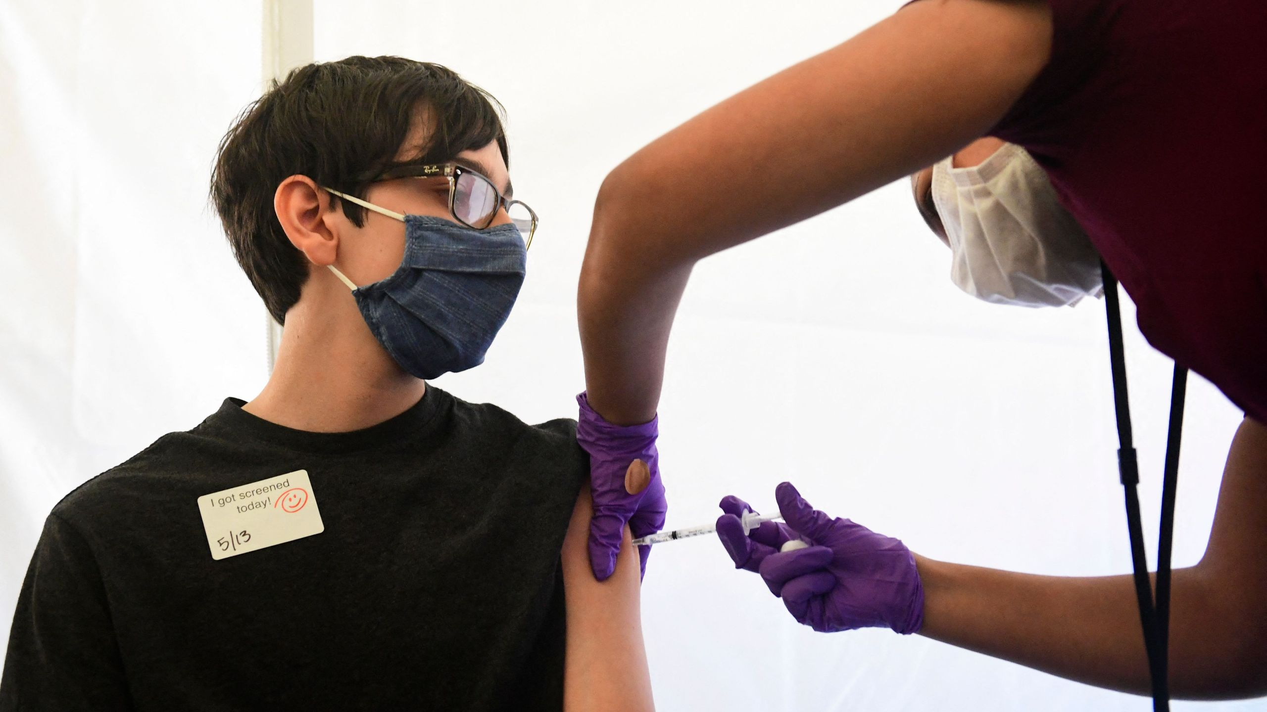 Photo of a boy receiving a COVID-19 vaccine
