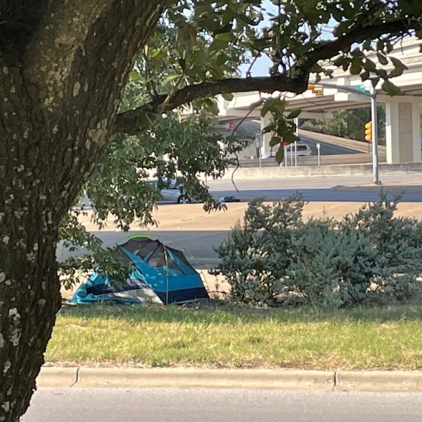 Photo of a tent set up off Highway 290