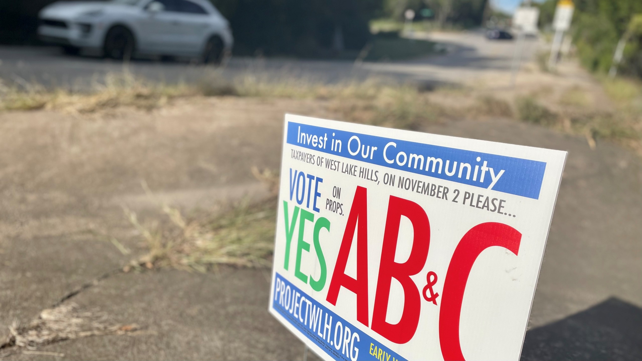 Photo of a sign advocating for the passage of Propositions A, B, and C in West Lake Hills