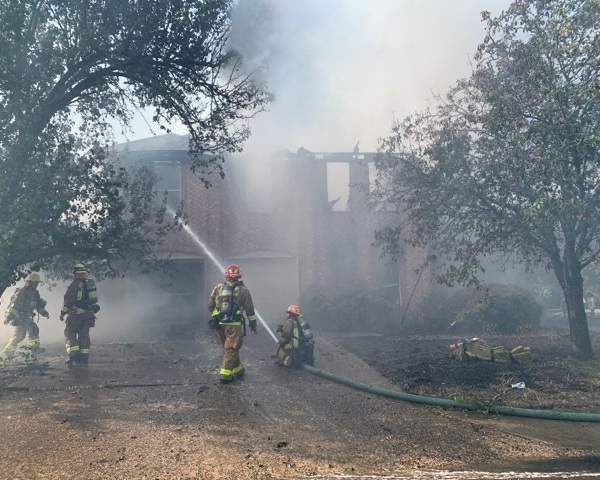 Austin firefighters work to put out blaze at home located at 10616 Pinkney Lane in southwest Austin (Austin Fire Department Photo)